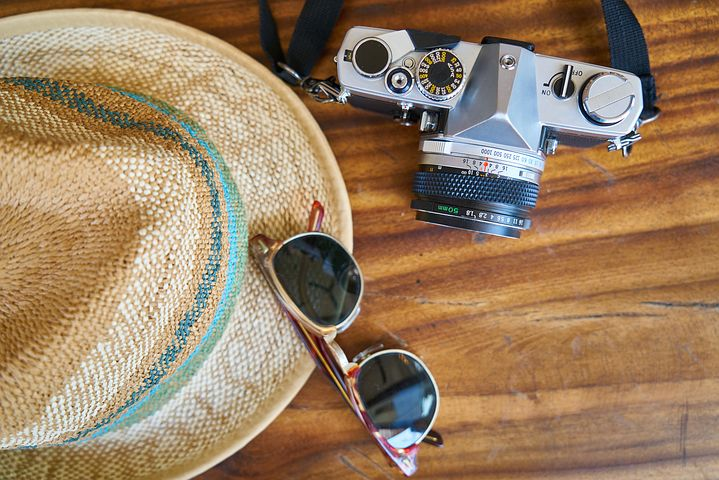 Sunglasses, hat and camera