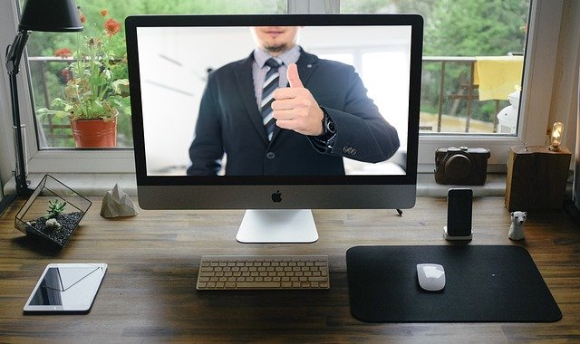 Computer screen with business man